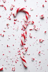 Crushed candy cane on white background, top view. Traditional Christmas treat