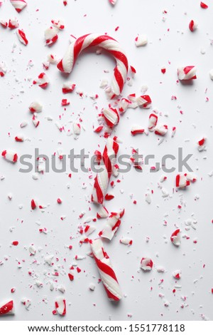Crushed candy cane on white background, top view. Traditional Christmas treat Foto stock ©