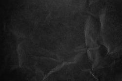 Crushed dark black  paper surface