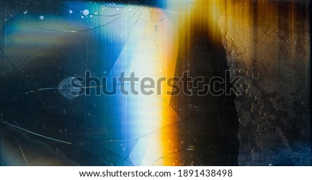 Crushed display overlay. Fractured texture. Colorful digital noise pattern on dark glass surface with yellow blue white gradient stains dust scratches. Stock foto ©