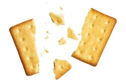 Crushed dry cracker, isolated on white background