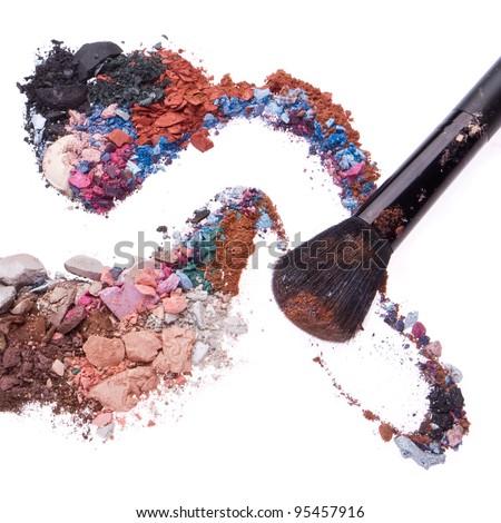 crushed eyeshadow mixed with brush isolated on white background - stock photo