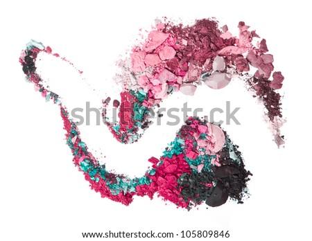 crushed eyeshadows mixed with brush isolated on white background