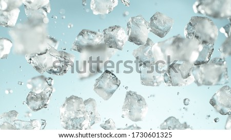 Photo of  Crushed ice explosion on blue background. Freeze motion of flying pieces of ice.