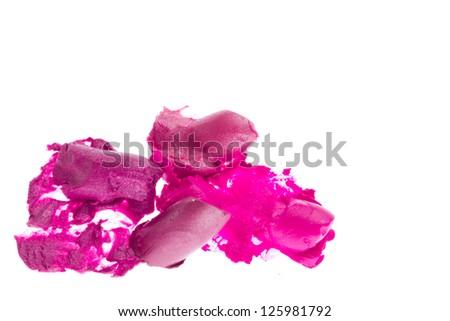 crushed lipsticks isolated on white background