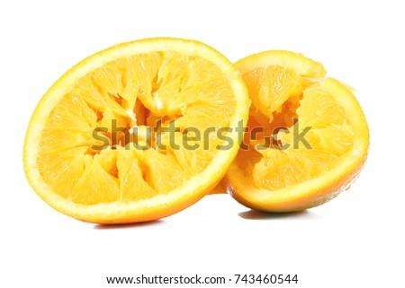 crushed orange on white background #743460544