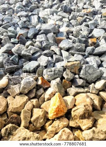 Crushed Orange stone on the ground texture background #778807681