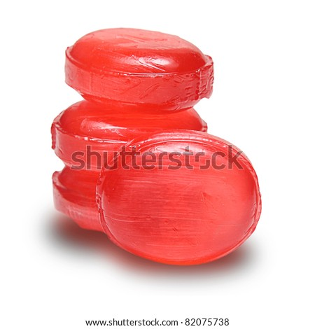 Crushed red tomato on wooden background.