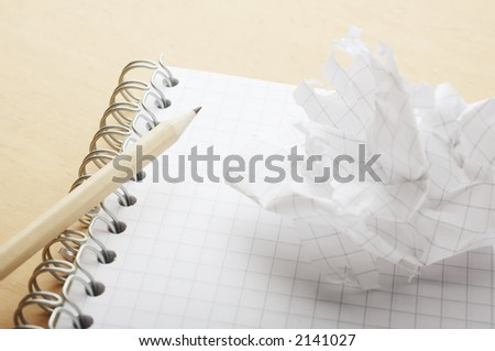 Crushed sheet of paper ripped of from notebook