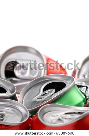 Crushed soft drink or soda cans ready for disposal and recycling with white copy space