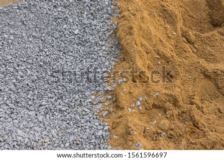 Crushed stone and sand texture. Building materials. Concrete materials.  #1561596697