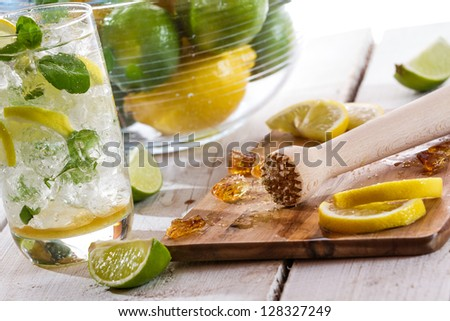 Crushed sugar and fresh citrus fruits for cold drink