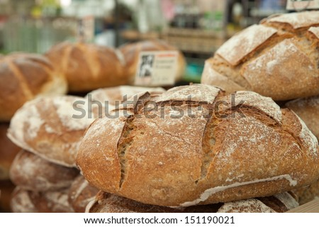 Crusty  fresh bread on sale at a market stall.