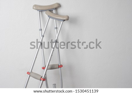 Crutches. Fractured legs. Crutches as a sign of disability. Symbol of disability. Rehabilitation in case of injury. Concept - workplace injury. Life with disabilities. Personal injury. Injuries.  Stock photo ©
