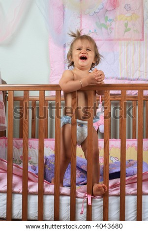 Crying baby girl wanting out of her crib