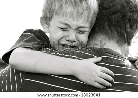 Crying Boy being comforted by his father