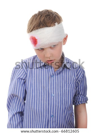 Crying boy with a bandaged head. Isolated on white background