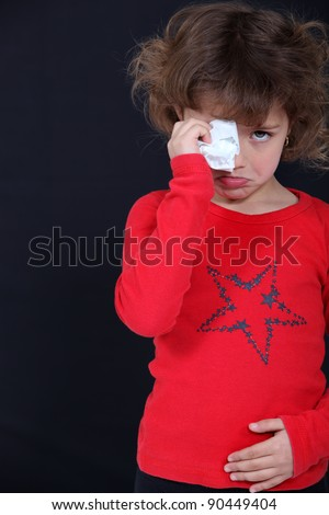 Crying child suffering from a stomach ache
