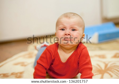 crying girl laying on bed