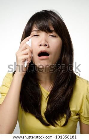 Crying girl wearing yellow shirt