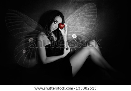 Crying girl with a red broken heart and butterfly wings