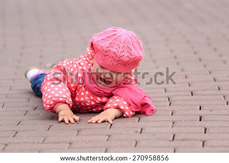 crying little girl fall off on sidewalk, kids safety