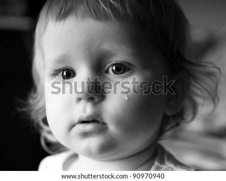 Crying little girl with focus on her tears
