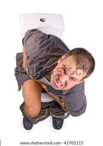 Crying man holding belly with Intestinal problems and sitting on the toilet bowl isolated on white background. Pain problem on toilet.