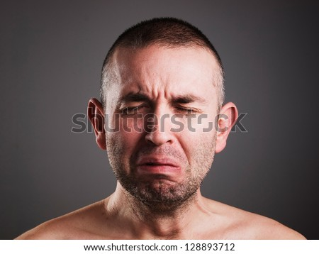 Crying man isolated on black background.