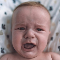 Crying, Sadness. Crying baby boy. Screaming baby. Photo of five month baby crying. Sad child portrait.  Baby cries and calls mum.