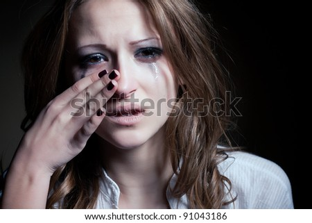 Crying young girl isolated