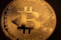 Crypto Coin, physical Bitcoin coin in gold. Digital currency concept representation of Cryptocurrency