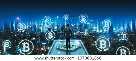 Crypto currency bitcoin and digital network concept, Professional business man walking on future smart city background at night in Bangkok, Thailand, Panorama view