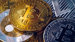 Crypto currency coin set collection, bitcoin, ethereum, litecoin, ripple. Digital currency. Cryptocurrency. Silver and golden coins with bitcoin, ripple, litecoin and ethereum symbol.