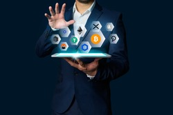 Cryptocurrency altcoin, Business man holding tablet showing growing virtual hologram of altcoin crypto and bitcoin, xrp, chainlink