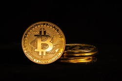 Cryptocurrency - Bitcoin stacked and isolated with a black background