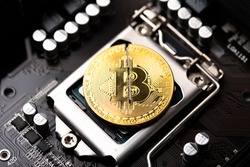 Cryptocurrency bitcoin with cutting traces in the middle on computer mainboard. sign of bitcoin halving the gennerate half of the  bitcoin from computer computing process