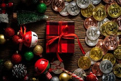 cryptocurrency business finance technology concept Cryptocurrency Bitcoin on the wooden table with christmas items decorating christmas shaopping online holiday backgrounds