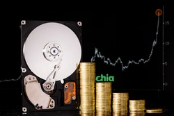 Cryptocurrency Chia and hard disk server for mining . New Crypto currency ChiaCoin virtual money concept on black background.