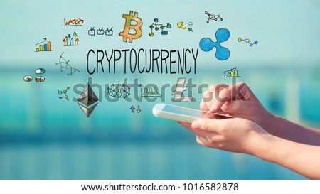 Cryptocurrency concept with person holding a smartphone #1016582878