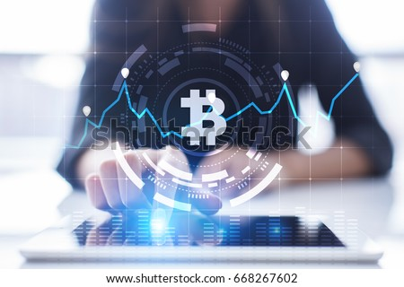 Photo of  Cryptocurrency graph on virtual screen. Business, Finance and technology concept. Bitcoin, Ethereum.