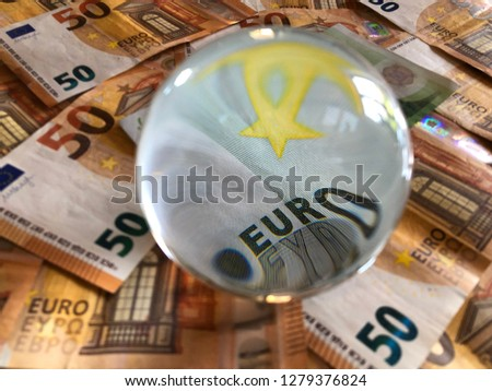 Crystal ball and euro banknotes. Creative concept, Predicting the European economic forecast