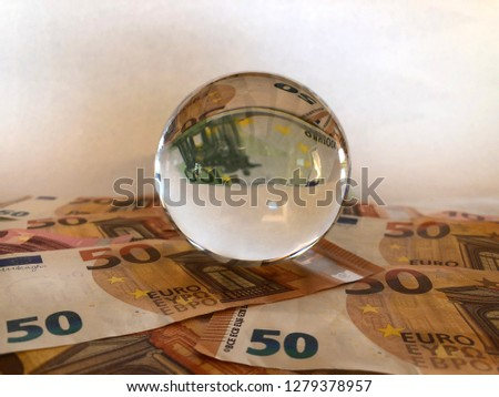 Crystal ball and euro banknotes. Creative concept, Predicting the European economic forecast #1279378957