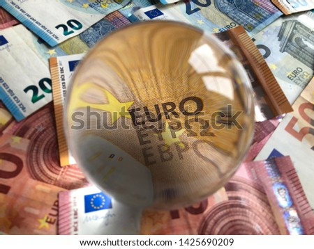 Crystal ball and euro banknotes. Creative concept. Predicting the European economic forecast. #1425690209
