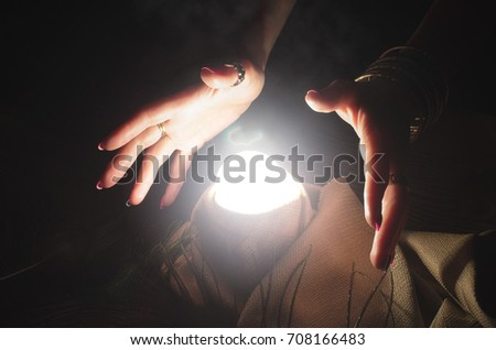 Crystal ball and fortune teller hands. Divination. Seance. #708166483