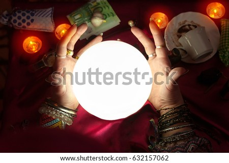 Crystal ball and hand of fortune teller woman around crystal ball #632157062