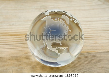 Crystal ball globe with wind farm over North America