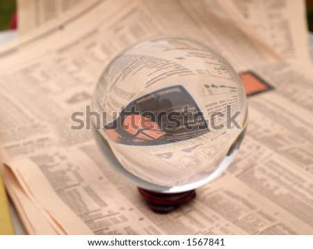 Crystal Ball on the financial section of a newspaper - stock photo