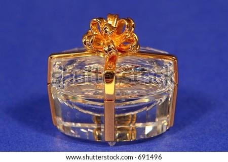 crystal box with gold ribbon