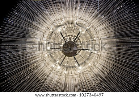 Crystal chandelier close-up. Clean background. Richly Theatrical Chandelier In Modern Vintage Interior With Modern Energy Saving Lamps